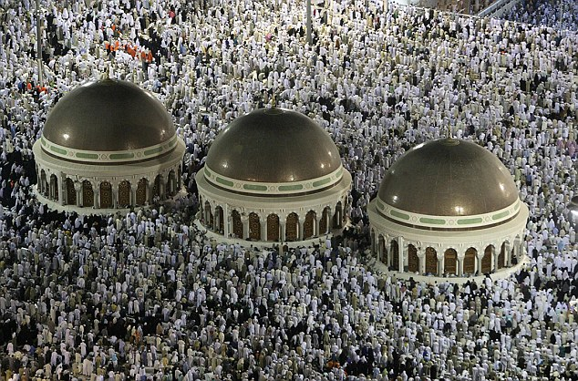 Muslims circle the Kaaba inside the Grand Mosque during night prayer in Mecca December 13, 2007. Around 1.5 million Muslims from around the world are expected to arrive in Saudi Arabia for the haj pilgrimage. REUTERS/Ali Jarekji (SAUDI ARABIA)